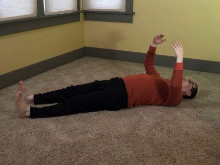 Holding the Moon Posture while on the floor.