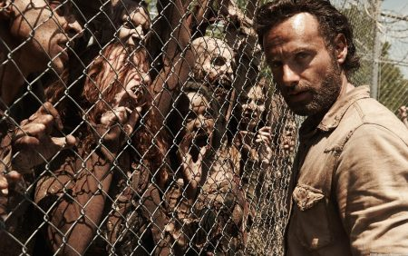 Walkers from The Walking Dead ready to overrun Rick's prison.